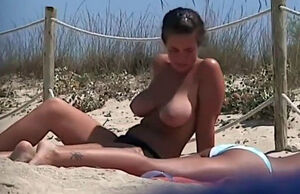 Braless young womans having joy in the..