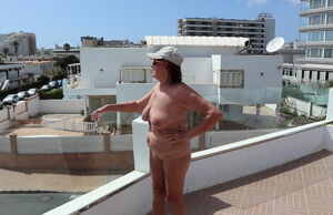 Posing nude on the roof of the motel 2