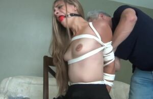 ballgagged sasha disrobes and submits..
