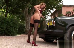 Edible Zoe disrobes down by a car