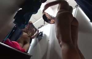 Hidden camera in the fitting room. A..